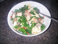 Scrambled egg with peppers and king prawns