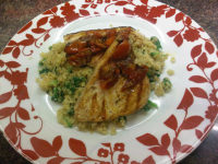 Char-grilled swordfish and coconut and spinach quinoa with tomato and garlic sauce