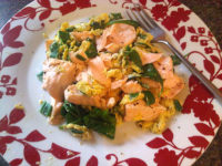 Poached salmon with scrambled eggs and spinach
