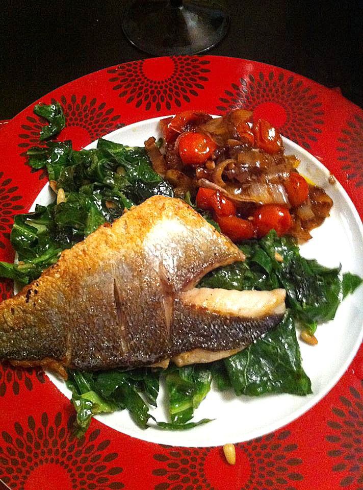 Pan fried sea bass with veg and pine nuts