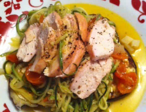 "Courgette ""pasta"" with cherry tomatoes & garlic on a bed of griddled aubergines, with roast chicken."